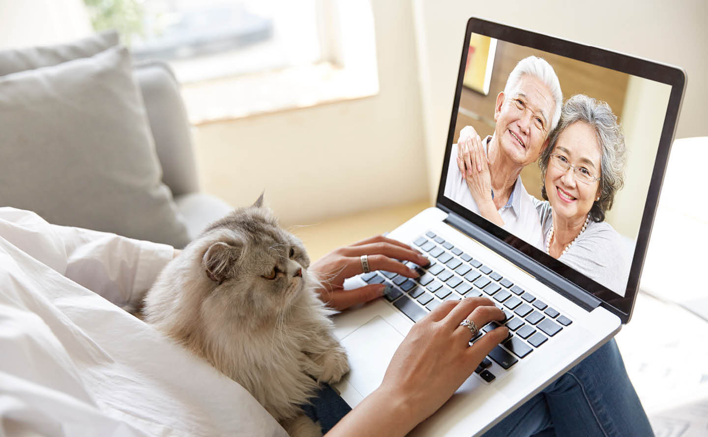Person video chatting with senior parents