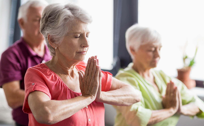Seniors enjoying a yoga class
