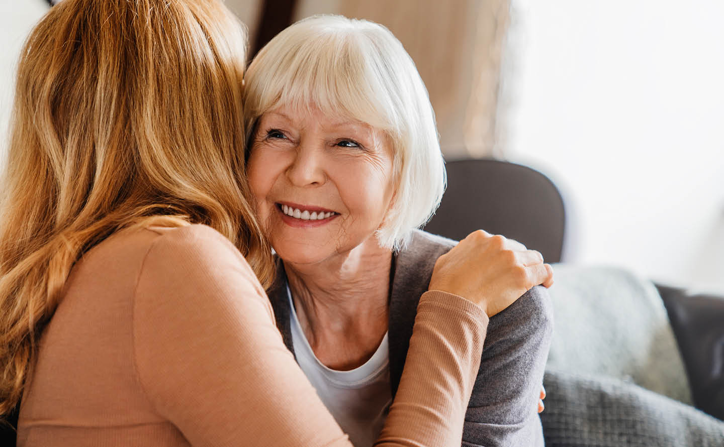 Senior mother and daughter embracing