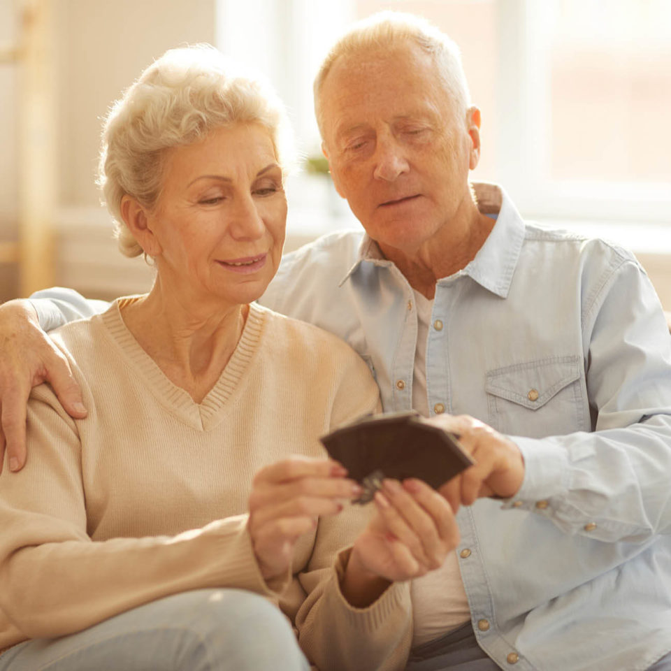 Senior couple looking at photos together.