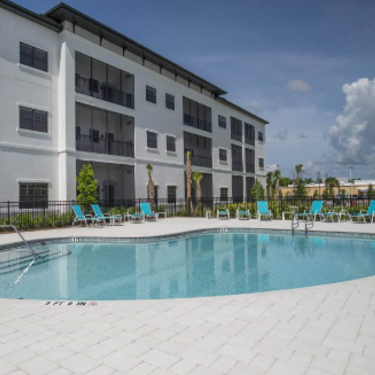 Pool, lawn chairs and balconies at Highpoint at Cape Coral